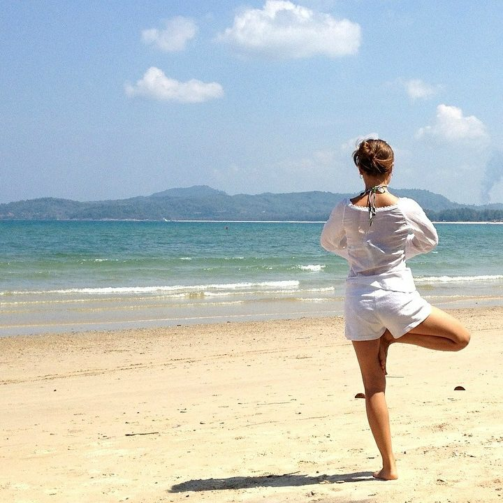 resized tree pose on beach